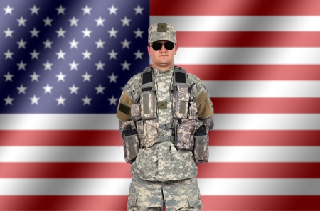 fatigues: us soldier on american flag background