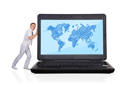 businessman pushing big laptop with world map photo
