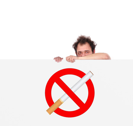 unhappy men holding big poster with no smoking symbol photo