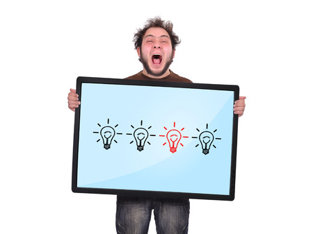 crazy man holding plasma panel with lamps photo