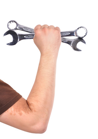 Worker holding wrench isolated on white photo