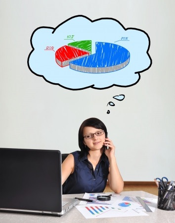 happy businesswoman sitting in office and chart photo