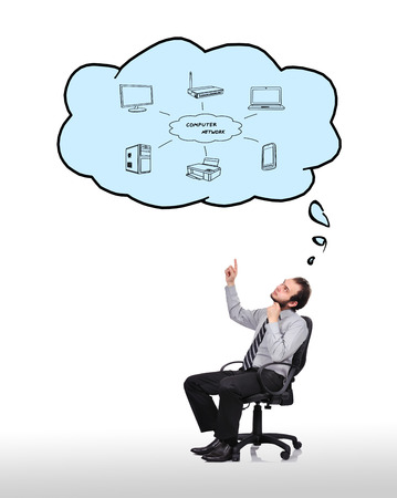 businessman sitting in chair and pointing to cloud with wifi concept photo