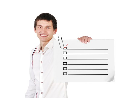 boy holding poster with checklist photo