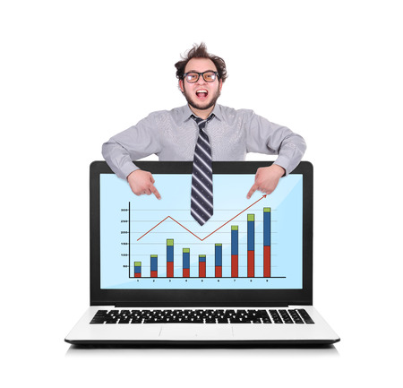 happy businessman pointing to laptop with chart photo