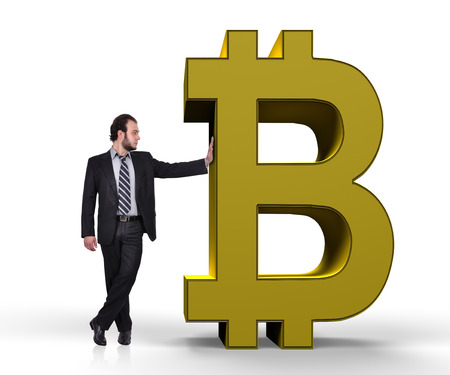 businessman holding golden symbol of bitcoin photo