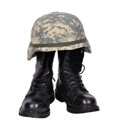 mobilization: military boots and helmet on white background