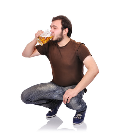 alcoholic man with beer on a white background photo