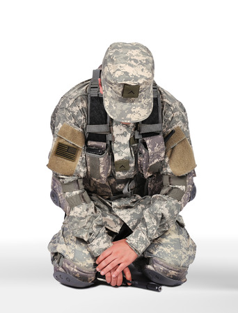 US soldier kneeling on white background photo