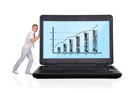 businessman pushing big laptop with business chart photo