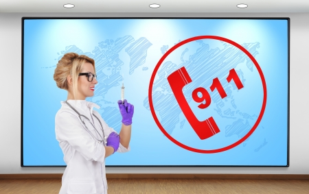 female doctor with syringe and 911 symbol on plasma panel photo