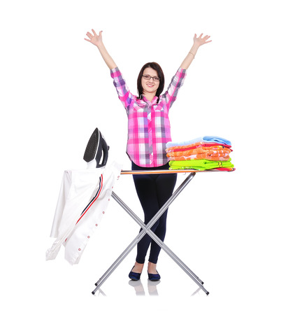 happy housewife ironing clothes on a white background photo