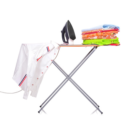 ironing board with a mans shirt and a household iron