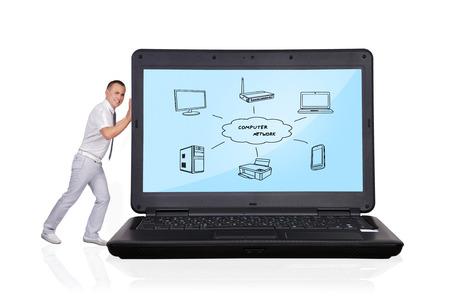 Businessman pushing laptop  on a white background
