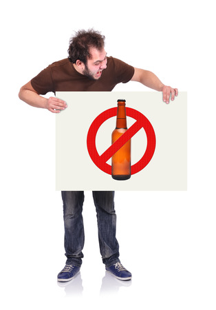 crazy man holding signboard with stop alcohol symbol photo