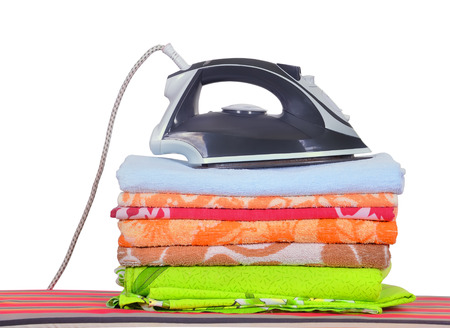 ironing board with a mans shirt and a household iron photo