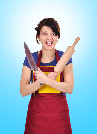 young housewife holding a rolling pin and knife photo