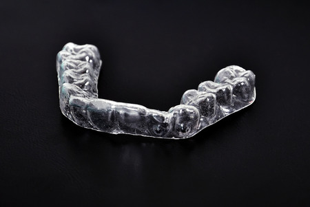 prosthetics: dental splint on a black background