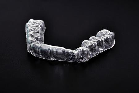 splint: dental splint on a black background