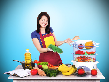 beautiful woman standing in kitchen with apron photo