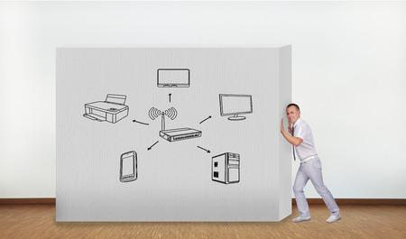 computer netzwerk: Gesch�ftsmann Dr�cken der Betonwand mit Computernetzwerk Lizenzfreie Bilder