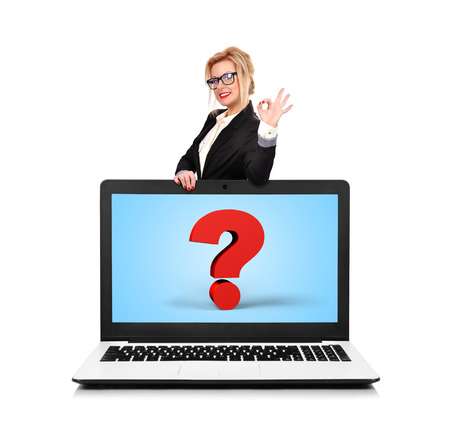 happy businesswoman standing near a laptop with question mark photo