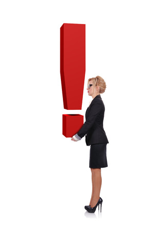 businesswoman holding a big red exclamation mark photo