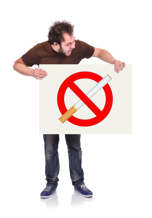 crazy man holding signboard with stop smoking photo