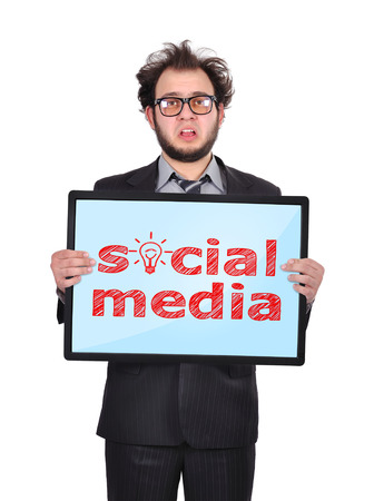sad businessman holding plasma panel with social media photo