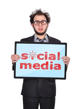 sad businessman holding plasma panel with social media photo
