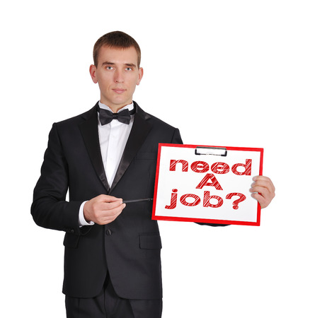 businessman in tuxedo holding clipboard with need a job photo