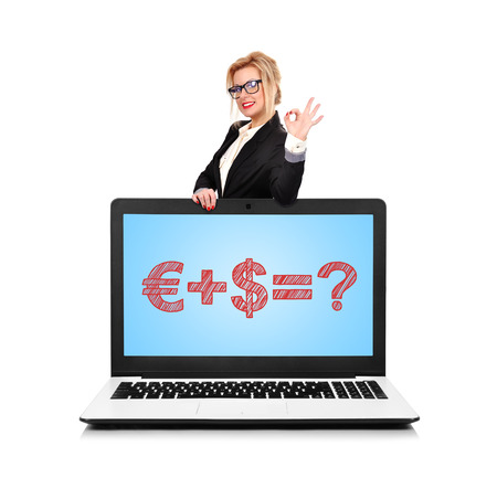 happy businesswoman standing near a laptop with money formula photo