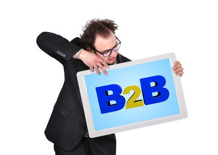 crazy businessman holding digital tablet  with b2b photo