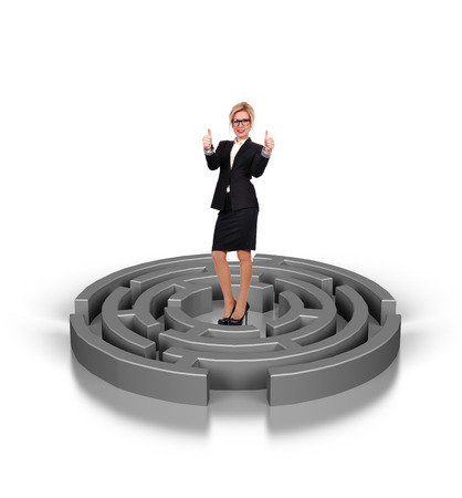 businesswoman standing in labyrinth on a white background photo