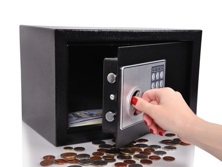 hand opened safe with dollars and cent