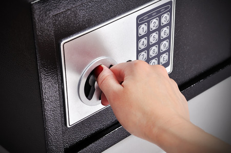 woman hand opened a safe, close up