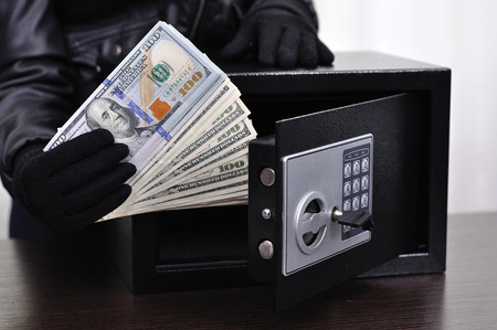 prowler: Thief steals dollars from the safe, close up