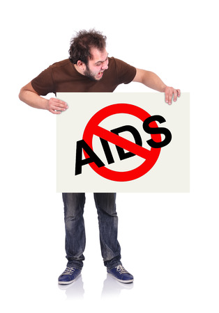 crazy man holding signboard with stop aids symbol photo