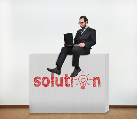 businessman sitting on concrete wall with drawing solution photo