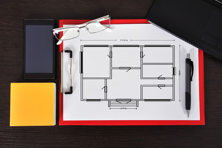 clipboard with drawing blueprint on table and business object photo