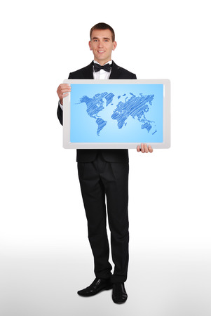 happy businessman  holding plasma panel  with world map photo