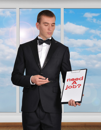 businessman holding clipboard with need a job photo