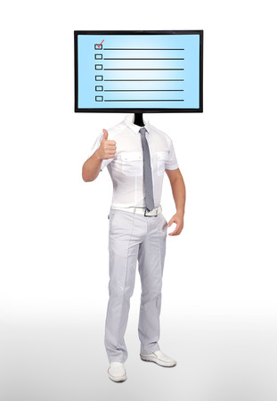 businessman and monitor for a head with check box photo