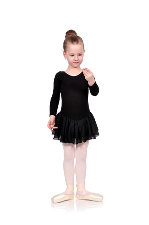 little ballerina standing on white floor photo