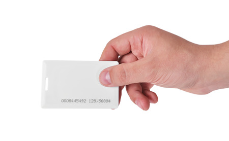 rfid: hand holding white RFID card, close up