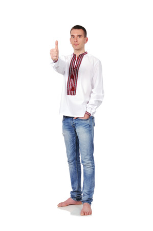gay in Ukrainian embroidered shirt with thumb up photo