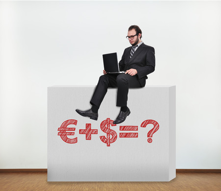 businessman sitting on concrete wall with money formula photo