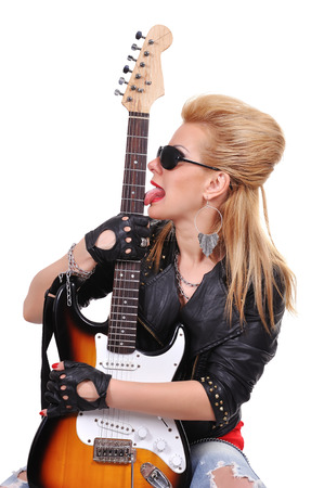 rock-n-roll girl licking tongue guitar photo