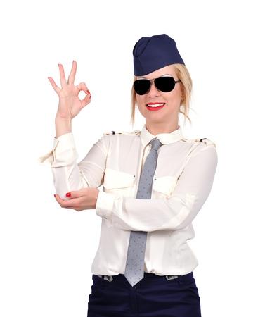 ok symbol: Assistente di volo che mostra simbolo OK su sfondo bianco Archivio Fotografico