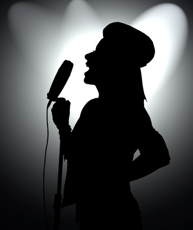 silhouette rock girl singer with microphone on black background photo